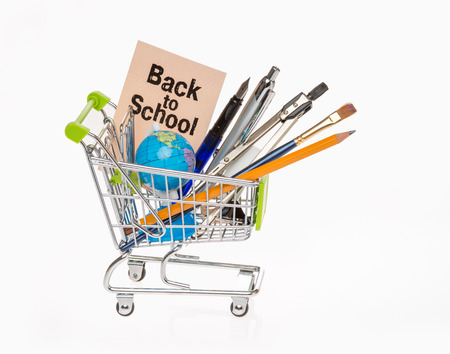 high resolution photo of trolley with school equipment on white background and a card with the words back to school photo