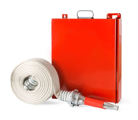 fire fighting equipment: Fire fighter hose with an indoor fire rack isolated on white background. Stock Photo