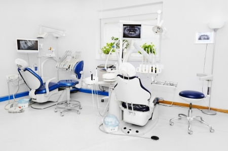dentists office: Dental office with blue dental chair Stock Photo