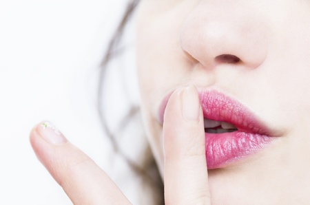 Beautiful lips with index finger, making a gesture of silence Stock Photo - 19798173