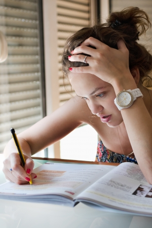Beutiful young girl studying for exame Stock Photo - 19798165