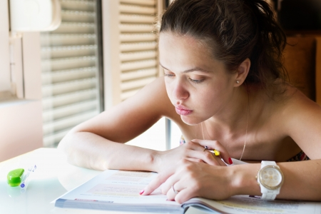 Beautiful young girl studying for exam Stock Photo - 19798166