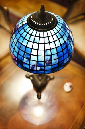 Tiffany lamp on wooden table photo
