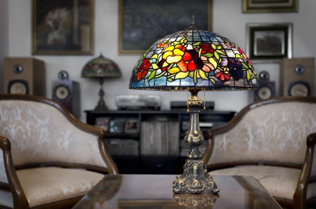 glass ceiling: Tiffany lamp on wooden table