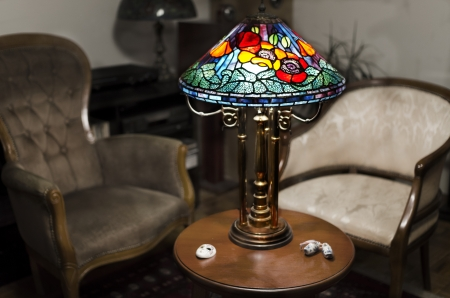 lamp made of stone: Tiffany lamp on wooden table