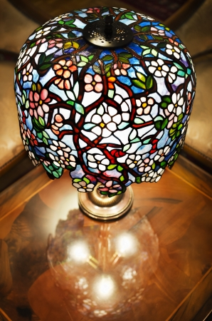 brass lamps: Tiffany lamp on wooden table