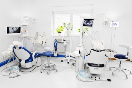 Dental office with blue dental chair Stock Photo