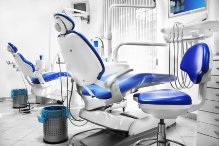 Dental office with two blue and white chairs