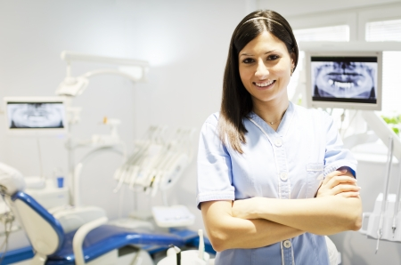 Portrait of a beautiful young woman doctor, dentist photo