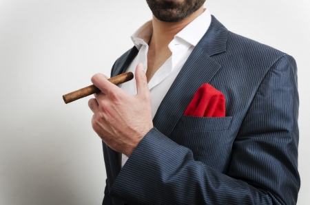 riches adult: Businessman in a suit with red handkerchief smoking cigare