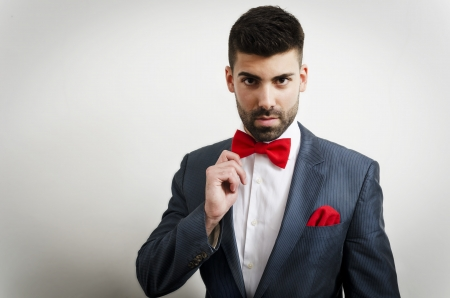 bowtie: Businessman in a suit with red handkerchief and bow tie