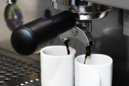 Close-up of an espresso machine making acup of coffee photo