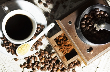 Cup of coffee on a white wooden table photo