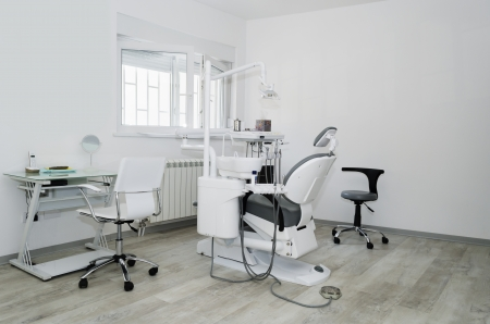 Dental office with dental chair photo