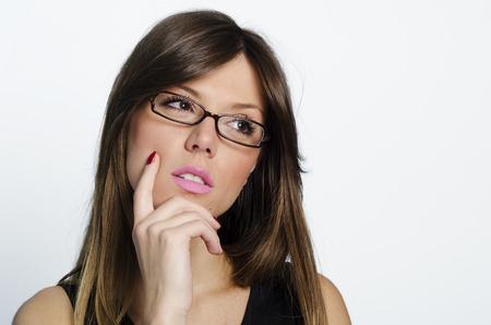 Portrait of doubtful looking beautiful young brunette. photo
