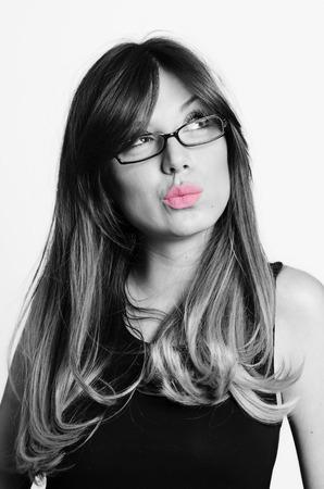 Portrait of doubtful looking beautiful young brunette. Stock Photo