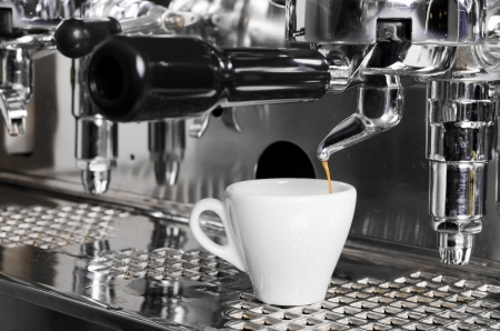 espresso machine: Close-up of an espresso machine making acup of coffee