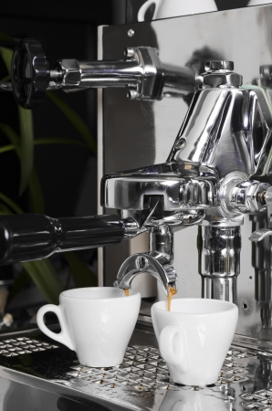 cappaccino: Close-up of an espresso machine making acup of coffee