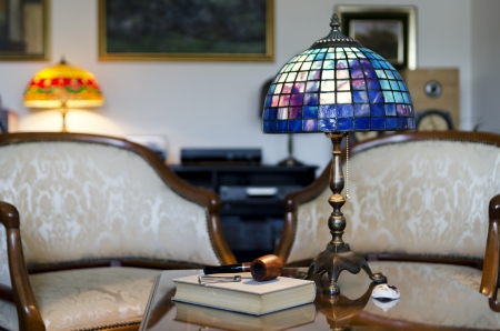 Beautiful hand made lamp on wooden table photo