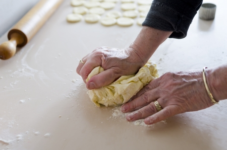 kneading: Kneading dough on wooden board