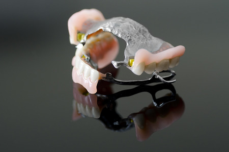 prosthetics: New dental prosthesis on black background
