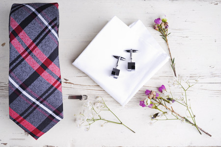 Men accesories on white wooden table