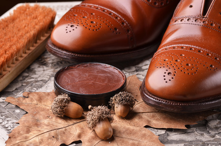 leather shoes: Brown leather shoes on table with polishing equipment