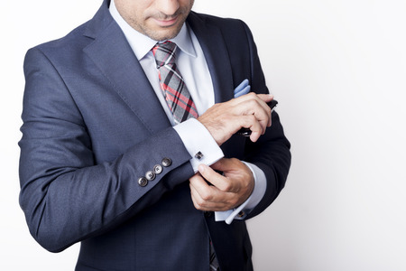 suit  cuff: Businessman in suit holding a phone Stock Photo