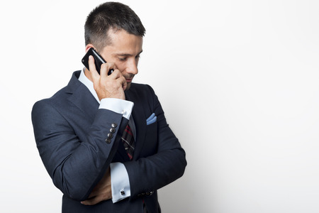 young  cuffs: Businessman in suit holding a phone Stock Photo