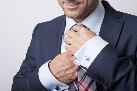 Man taking his tie off photo