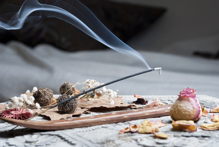 Incense stick on wooden table