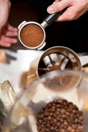 tamper: Barista with tamper and pistonportafilter making espresso. Stock Photo