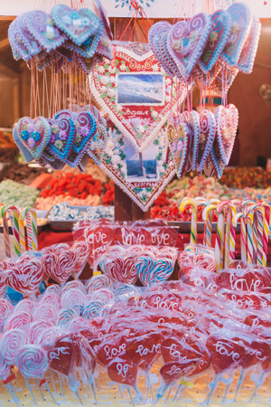 Heart shaped candies, lollypops and other treats and gifts, on the street, vintage style, retro filtered look photo