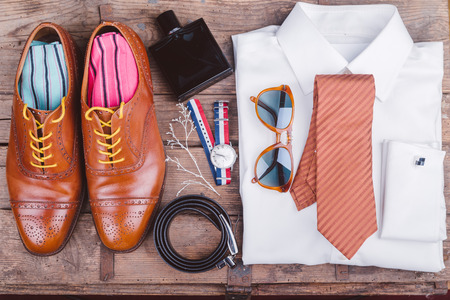 Men accessories on vintage wooden table photo