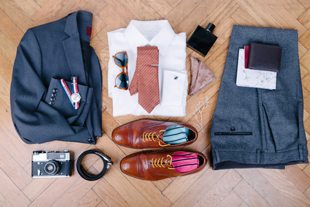 formal dressing: Men accessories on vintage wooden table