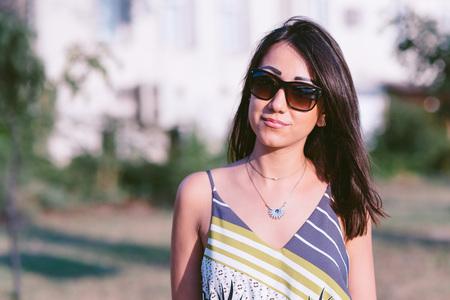Beautiful brunette outdoors, natural looking girl