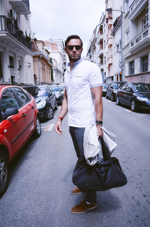 Young fashion man with glasses on the streets of the city Stock Photo