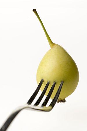 yelow: yelow pear stuck on fork