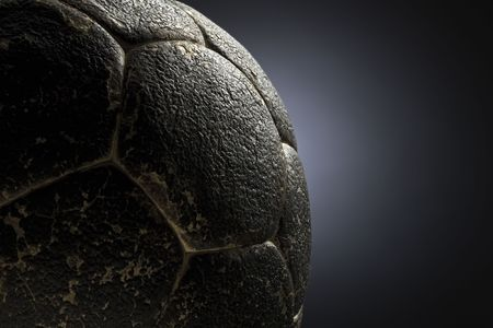 dirty football: detail of an old leather soccer ball