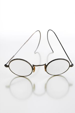 rimmed: old rimmed glasses on white