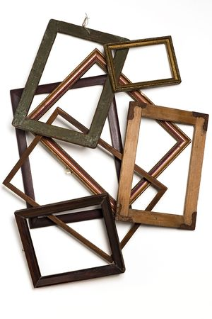 stack of old wooden frames on white photo