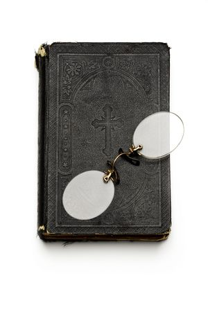 rimless: a pair of rimless glasses on an old bible