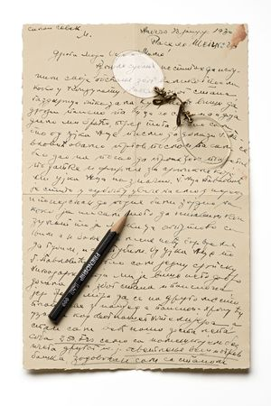 rimless: an old letter with a pair of rimless glasses and a friendship pencil on it