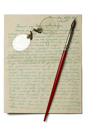 rimless: an old letter with a pair of rimless glasses and a calligraphy pen on it