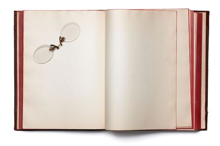 rimless: rimless glasses on a blank book spread