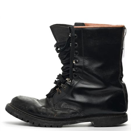 wornout: black army worn-out boot on white
