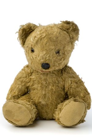 a very old and shabby teddy bear on white Banco de Imagens