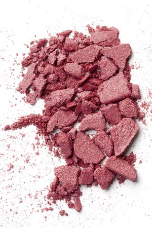 talcum: broken makeup particles on white Stock Photo
