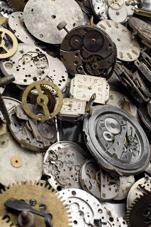 a bundle of grunge watch and clock pieces - focus in the back Stock Photo - 2064138