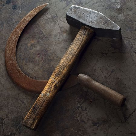 hammer and sickle on a grunge floor photo